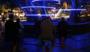 CYCLE! by Clouston Associates, exemplifies the Smart Light ethos. Popular in Sydney and Singapore, its blue LED tree-rings are user-activated by pedal power.